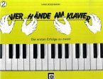 Vier Hände am Klavier