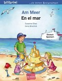 Am Meer. Kinderbuch Deutsch-Spanisch