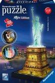 Ravensburger 12596 - Freiheitsstatue bei Nacht, 3D-Puzzle 108 Teile